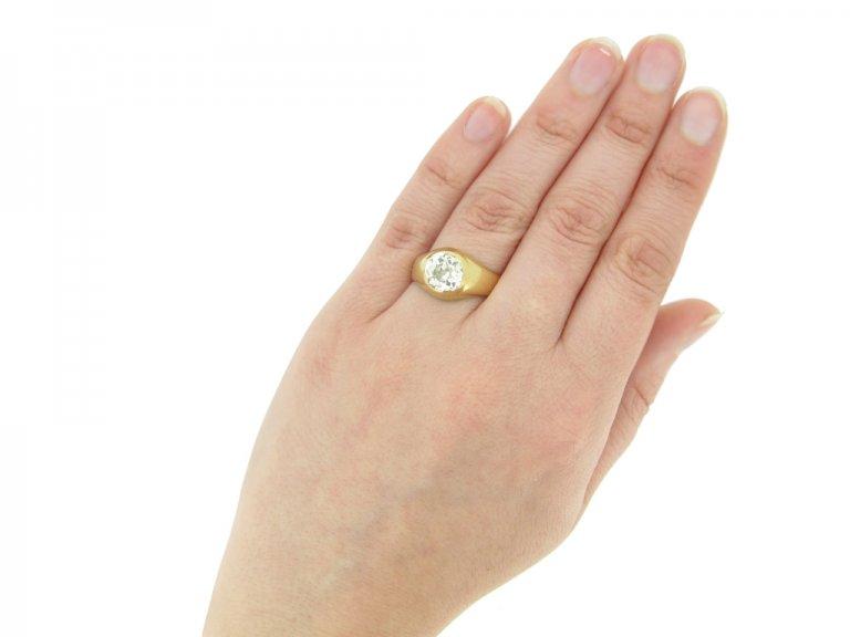 hand veiw Cushion shape old mine diamond ring, circa 1900.