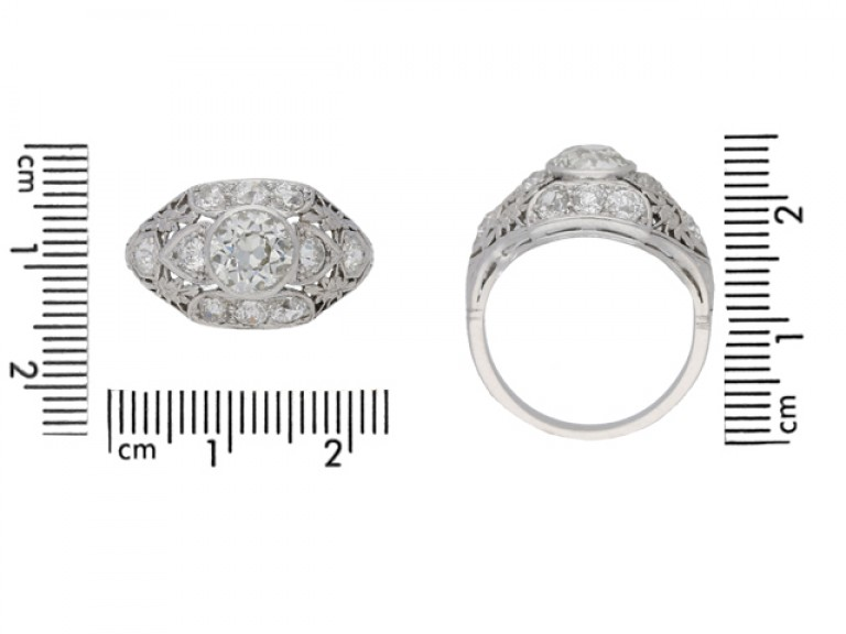 Old cut diamond cluster ring in platinum, circa 1920.