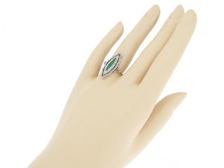 hand view Antique emerald and diamond ring, circa 1900.