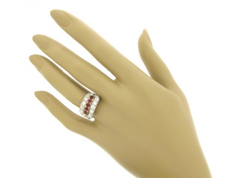 hand view Ruby and diamond saddle ring, circa 1920.