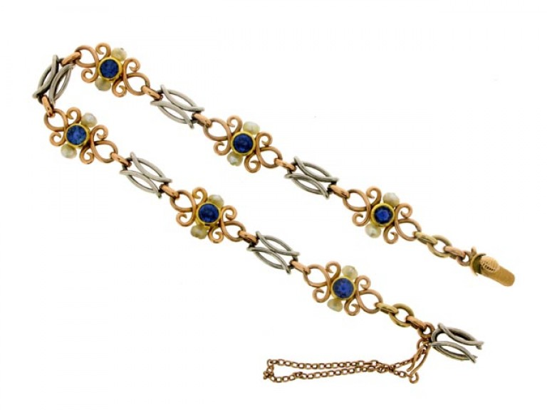 side view Sapphire and Natural Pearl Bracelet in Platinum and Gold.