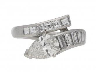 Drop, baguette and square cut diamond ring, circa 1960.