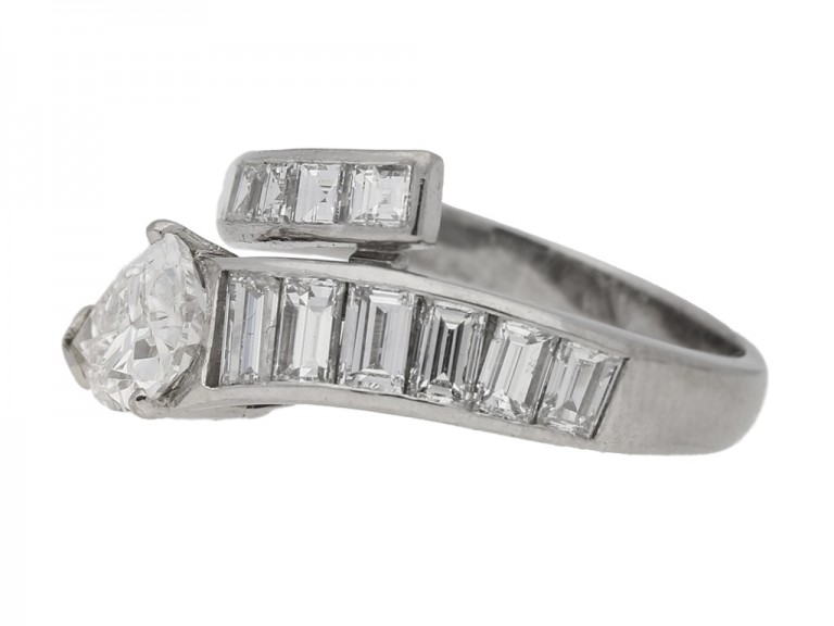 side veiw Drop, baguette and square cut diamond ring, circa 1960.