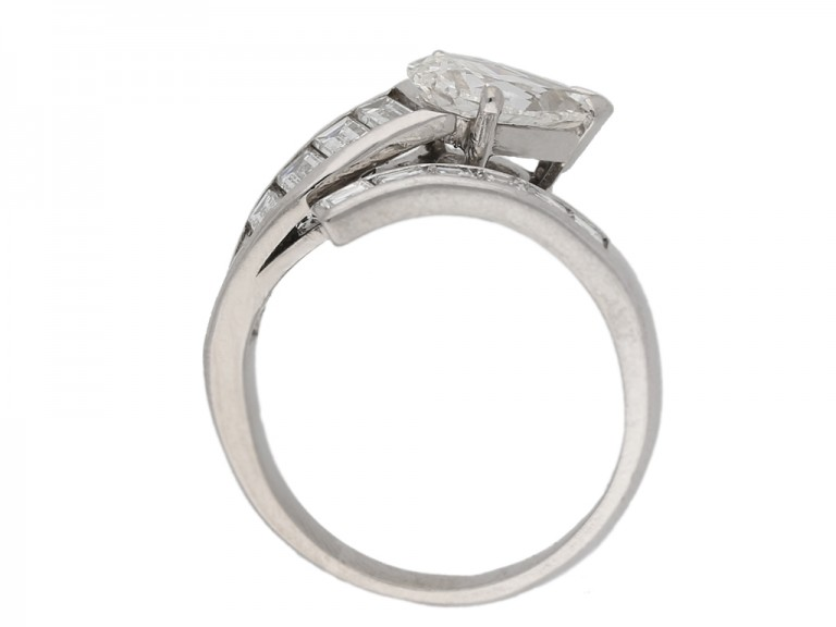 back view Drop, baguette and square cut diamond ring, circa 1960.