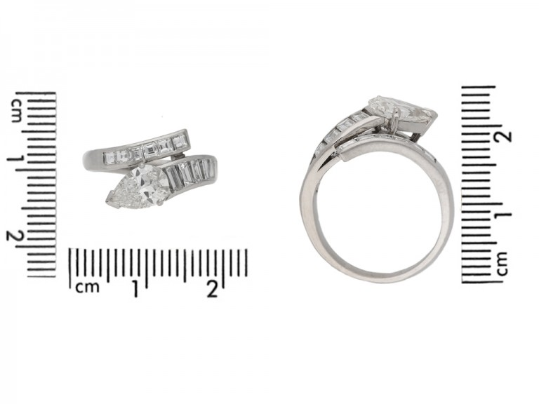 size veiw Drop, baguette and square cut diamond ring, circa 1960.