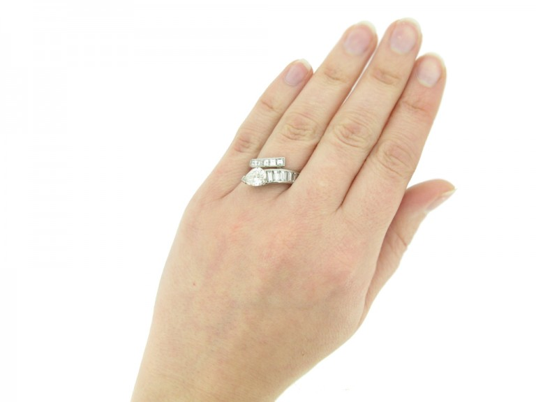 and veiw Drop, baguette and square cut diamond ring, circa 1960.