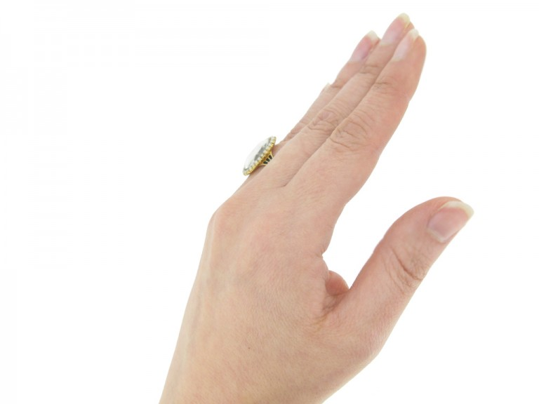 hand view Antique diamond and pearl 'urn' memorial ring, circa 1780.