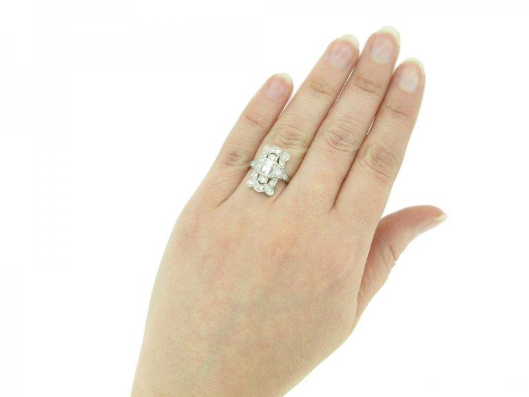 hand view Vintage diamond cluster ring, American berganza hatton garden