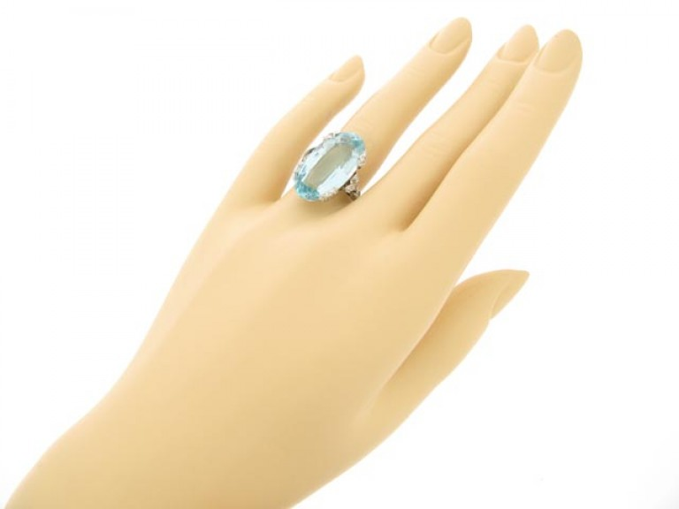hand=view Aquamarine and diamond ring, circa 1920.