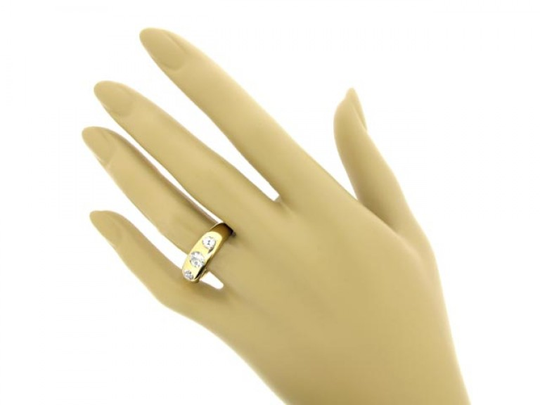 hand view Diamond three stone gypsy ring,