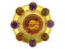 front view Antique brooch set with citrines and amethysts